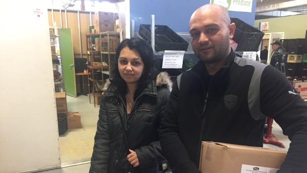 Recent immigrants from Slovakia get food from the Daily Bread Food Bank.