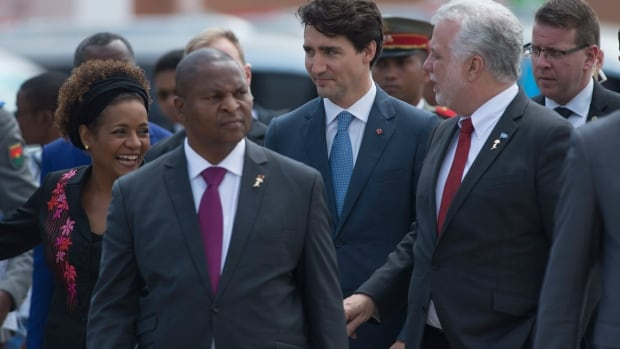 Canadian Prime Minister Justin Trudeau, Quebec Premier Philippe Couillard and Secretary General of the International Organization of la Francophonie Michaelle Jean speak as they walk to lunch at la Francophonie summit in Antananarivo, Madagascar,