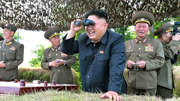 Most North Koreans have a distorted view of life outside the insular nation, and the country's president, Kim Jong-un, with binoculars above, likes it that way.