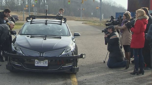 One of three automated cars to begin driving on Ontario roads gets its closeup in Waterloo, Ont., today. The province has a 10-year pilot program to foster innovation in self-driving technology.