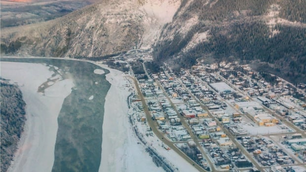 Open water flows near Dawson City in a spot where people would usually be driving vehicles this time of year. Lifelong resident and photographer Will Fellers says it's very unusual.