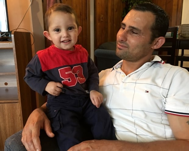 Ibrahim Tonbari with youngest child Hilal