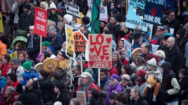 Thousands of people march during a protest against the Kinder Morgan Trans Mountain Pipeline expansion in Vancouver, B.C., on Saturday Nov. 19, 2016.