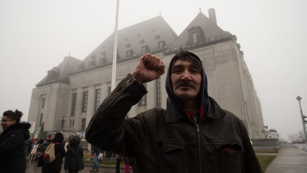 Jerry Natanine, former mayor of Clyde River, Nunavut, gestures outside the Supreme Court in Ottawa. I