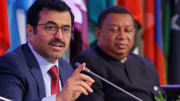 OPEC president and Qatar's Energy Minister Mohammed bin Saleh al-Sada announced a 1.2 million barrel a day cut to production in Vienna. OPEC Secretary General Mohammad Barkindo, right, also addressed a news conference after the meeting.