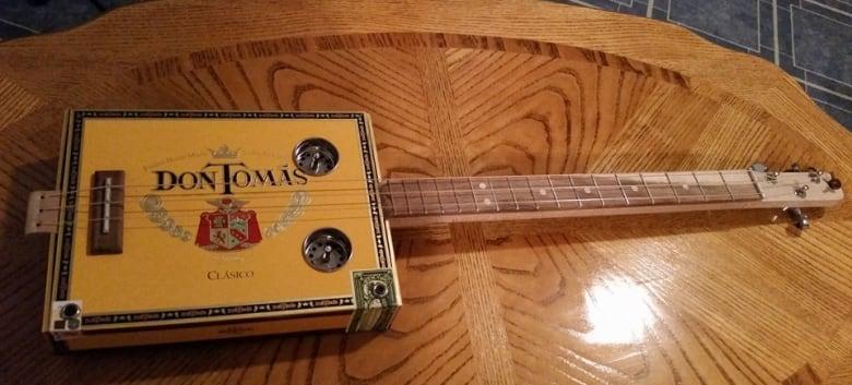 making cigar box guitars p e i man 39 s new passion cbc news. Black Bedroom Furniture Sets. Home Design Ideas