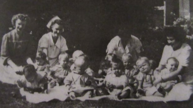 Photo of babies and staff from an official brochure of the Ideal Maternity Home.