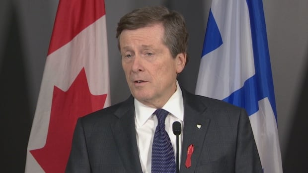 Toronto Mayor John Tory's controversial road toll plan cleared one city hall hurdle on Thursday by winning executive committee approval.