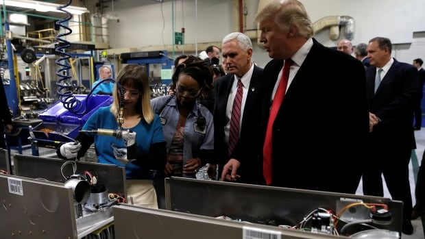 U.S. president-elect Donald Trump tours a Carrier factory with vice-president-elect Mike Pence in Indianapolis. Trump says his administration plans on lowering business taxes and cutting regulations.
