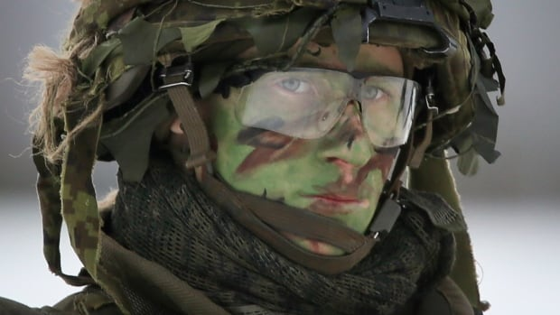 An Estonian soldier wears camouflage makeup during the multinational military exercise 'Iron Sword 16' near Vilnius, Lithuania, in December. Canadian troops will deploy into Latvia, a neighbouring Baltic state, in June as part of NATO's deterrence force.