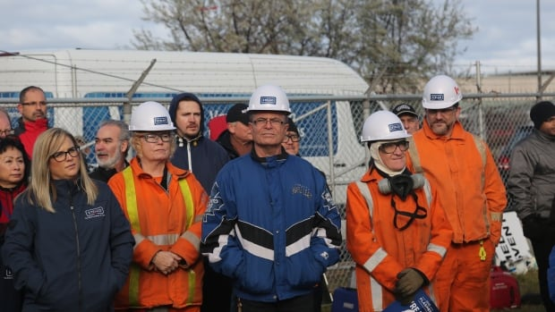 Steelworkers attended a December announcement to announce a name change from U.S. Steel Canada to Stelco, many already wearing hard hats with the new logo on them.