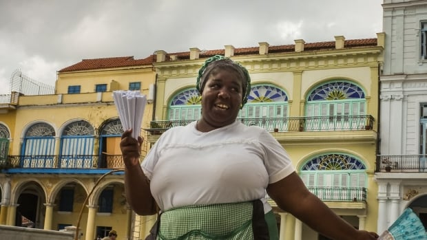 In Cuba, low government wages force many people to take on second jobs, including selling black market items on the street.