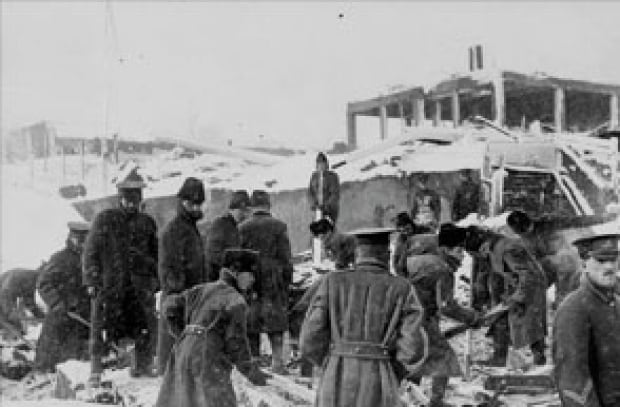 Soldiers search the ruins after the disaster.
