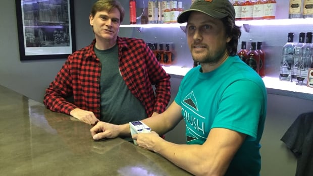 Greg Lipin, left, and partner Jody Miall, say a proposed tax would put a lot of pressure on their three-year-old craft distillery.