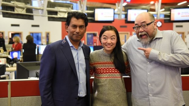 Ian Hanomansing poses with Kim's Convenience stars Paul Sun-Hyung Lee and Andrea Bang at the 2016 CBC Vancouver Open House & Food Bank Day.