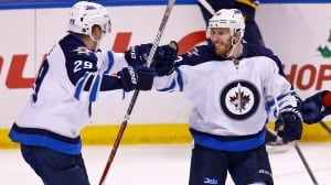 Jets' Laine sets up Little for OT winner against Blues