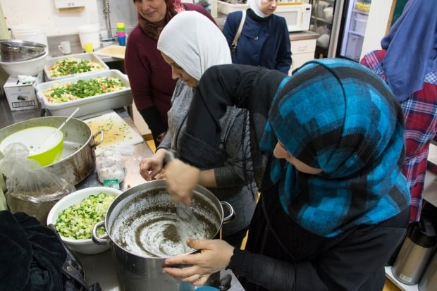 Syrian refugee women Mount Pleasant Neighbourhood House food prep
