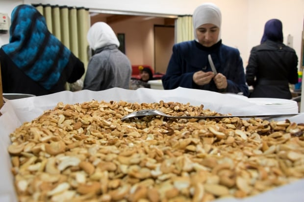 Syrian refugee women mount pleasant neighbourhood house food prep nuts