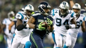 Seahawks rout Panthers, but lose Thomas