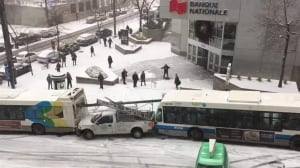 City buses, police vehicle and salt truck collide on slippery roads