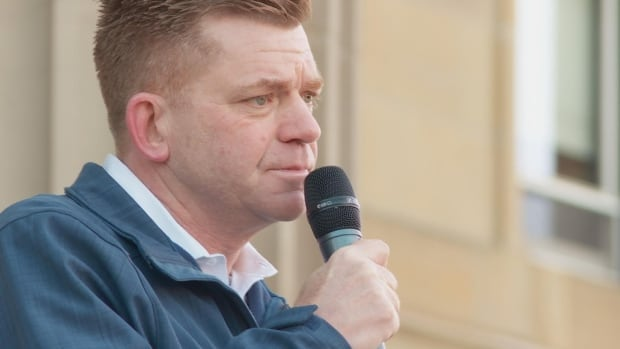 """Wildrose Leader Brian Jean seen here speaking at the rally Saturday is denouncing people who held homophobic signs and chanted """"lock her up"""" about Premier Rachel Notley."""