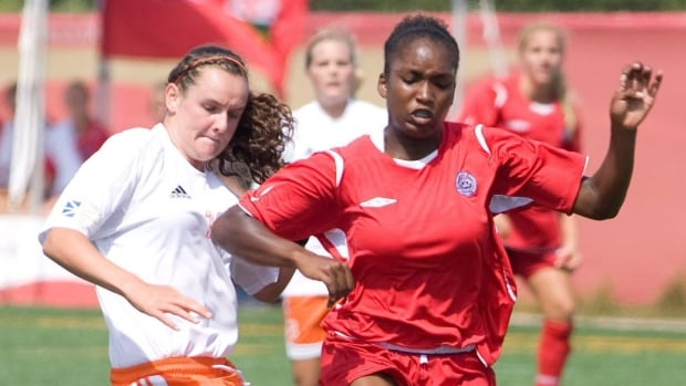 Newfoundland and Labrador's Kiley DeLong (left) and Ontario's Christine Exeter battle for the ball during womens soccer quarter finals at the 2009 Canada Summer Games in Summerside, P.E.I.