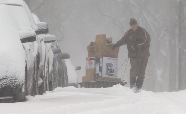 UPS delivery man uses sled during Winnipeg storm