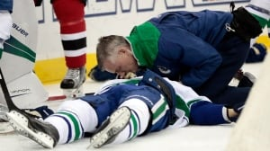 Canucks' Larsen leaves on stretcher after huge hit by Hall