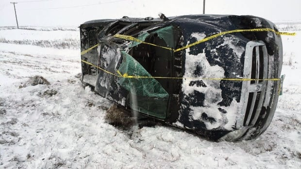 A pickup truck lies on its side after a rollover on the Perimeter Highway, east of Brady Road, on Wednesday morning. CBC videographer Trevor Brine described the Perimeter as an ice rink.
