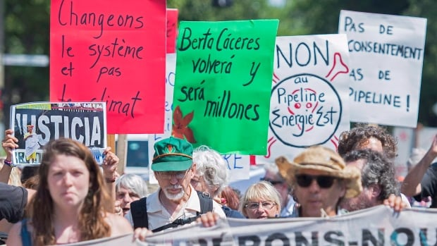 Protesters demonstrated against the building of the Energy East pipeline last summer in Montreal. A Senate committee is calling for the National Energy Board's approval process to be modernized and depoliticized, including adding Indigenous representation to the board.