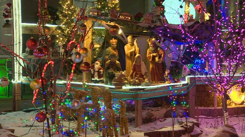 A nativity scene is part of the lighted display outside the home of Charles  Al-Homeira in southwest Edmonton. (CBC) - Edmonton Home Aglow With Christmas Cheer CBC News