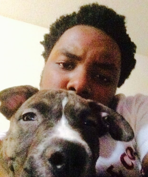 Leslie Mwakio with dog homicide victim provided by family