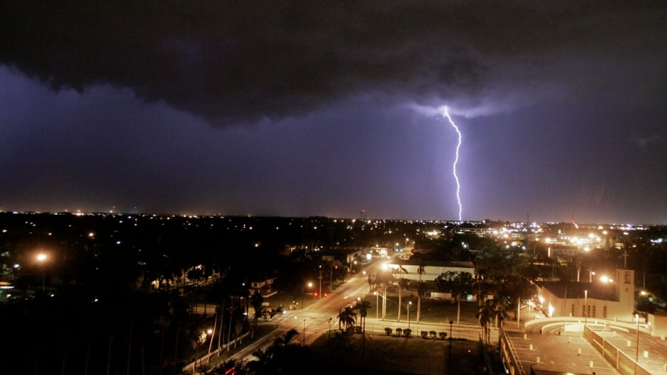 Lightning strikes the ground as a violent thunder storm approaches the area August 16, 2004 in Ft. Myers, Florida.