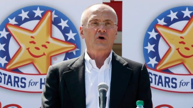 CKE Restaurants CEO Andy Puzder speaks at a news conference in Austin, Texas in August 2014. Puzder has frequently argued in the media against higher minimum wages.