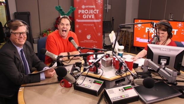 The Ottawa Morning team kicks off the Project Give 2016 fundraiser for the Ottawa Food Bank. From left to right: news reader David Gerow, traffic reporter Doug Hempstead, and host Robyn Bresnahan.
