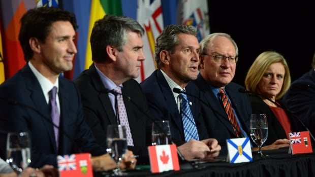 Manitoba's Brian Pallister, centre, talks as Prime Minister Justin Trudeau and, from left, Nova Scotia Premier Stephen McNeil, P.E.I. Premier Wade MacLauchlan and Alberta Premier Rachel Notley listen during the closing press conference of the First Ministers Meeting in Ottawa Friday. Pallister and Saskatchewan Premier Brad Wall did not sign a pan-Canadian climate framework reached at the meeting.