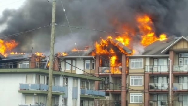 Witnesses said flames were 20 to 30 feet higher than the four-storey building and seemed to be coming from the centre of the massive complex.