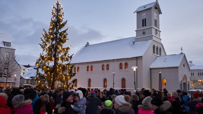 people attend the lighting ceremony of the christmas tree in front of the domkirkjan reykjavk catherdal in the city center of reykjavk iceland - Christmas In Iceland
