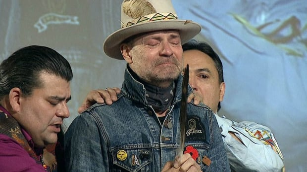 Gord Downie, lead singer of the Tragically Hip and an advocate for First Nations people, was honoured at the Assembly of First Nations gathering in 2016 for his work highlighting the impact of residential schools. Don Speidel , left, presented Downie with an eagle feather.