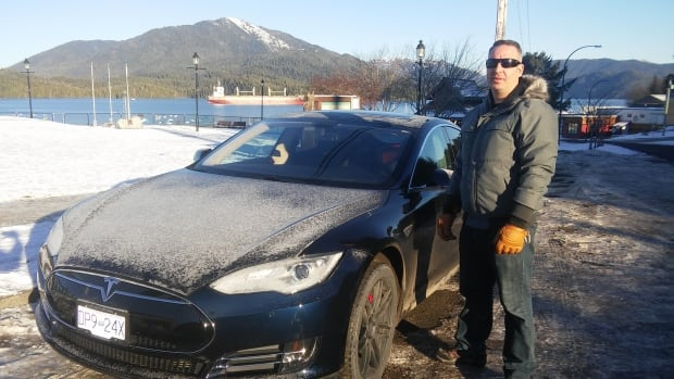 Prince Rupert resident Brian Lutz with his Tesla, an electric vehicle.