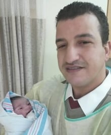 Mohamed Al Abdallah with baby