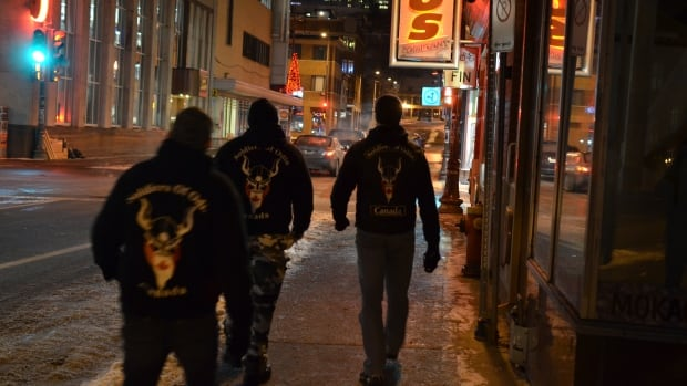 The Soldiers of Odin, whose Quebec City members are shown on patrol in December 2016, have been called intimidating.