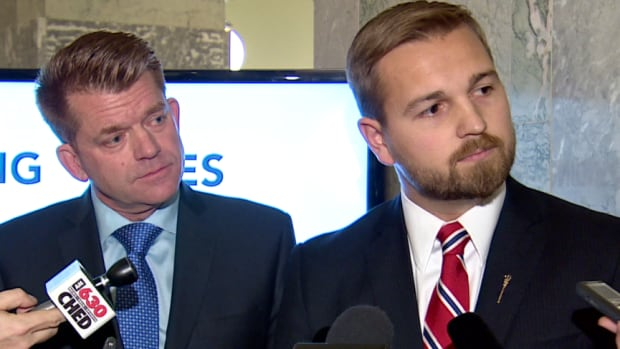 Wildrose MLA Derek Fildebrandt, right, says the Wildrose should merge with the PCs. Wildrose leader Brian Jean, left, has been opposed to the idea.