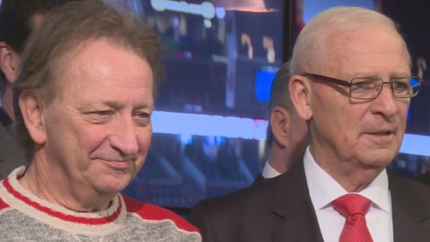 Ottawa Senators senior advisor Bryan Murray (right) stands for a group photo with the team's owner, Eugene Melnyk, after being named the first member of the team's Ring of Honour on Dec. 16, 2016.