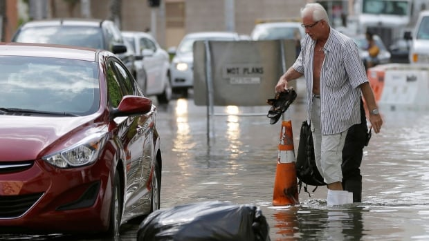 The street flooding in Miami Beach, Fla., in 2015, was in part caused by high tides due to the lunar cycle, according to the National Weather Service. A new scientific report finds man-made climate change played some kind of role in two dozen extreme weather events around the world in 2015.