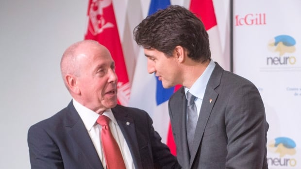 Donor Larry Tanenbaum, left, is thanked by Prime Minister Justin Trudeau after his speech at the Montreal Neurological Institute.
