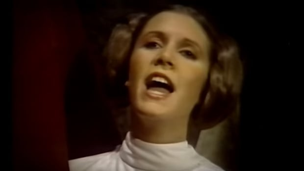 The Star Wars Holiday Special ends with Carrie Fisher as Princess Leia singing a hymn of peace amongst humans and wookies. For some reason, the Holiday Special remains unpopular with fans of the Star Wars series.