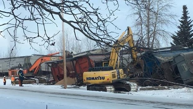 Crews remain on scene Saturday cleaning up after a train derailed in Fawcett, Alta.
