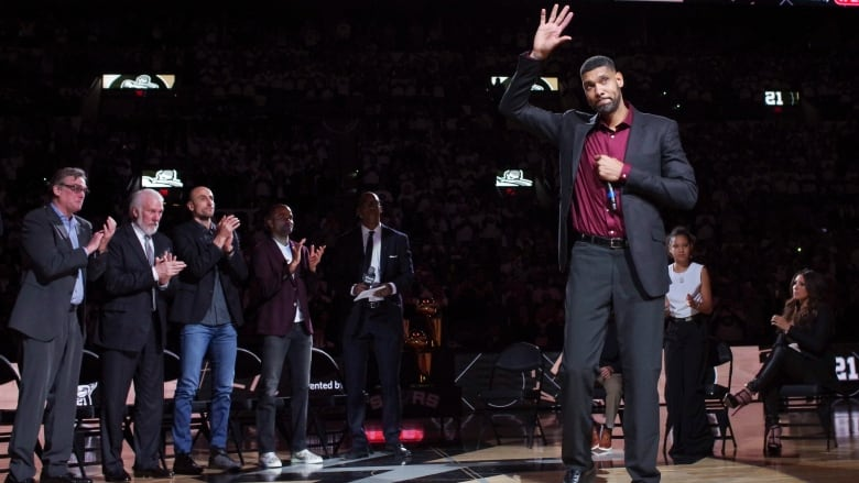 b222a9c96de San Antonio Spurs  Tim Duncan waves to fans during his jersey retirement  ceremony on Sunday. (Darren Abate The Associated Press)