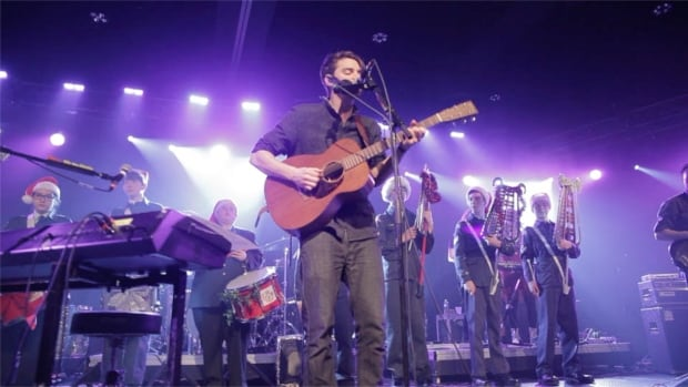 Hey Rosetta!'s Tim Baker performs while surrounded by cadets one of the band's annual Christmas shows in St. John's in 2016.